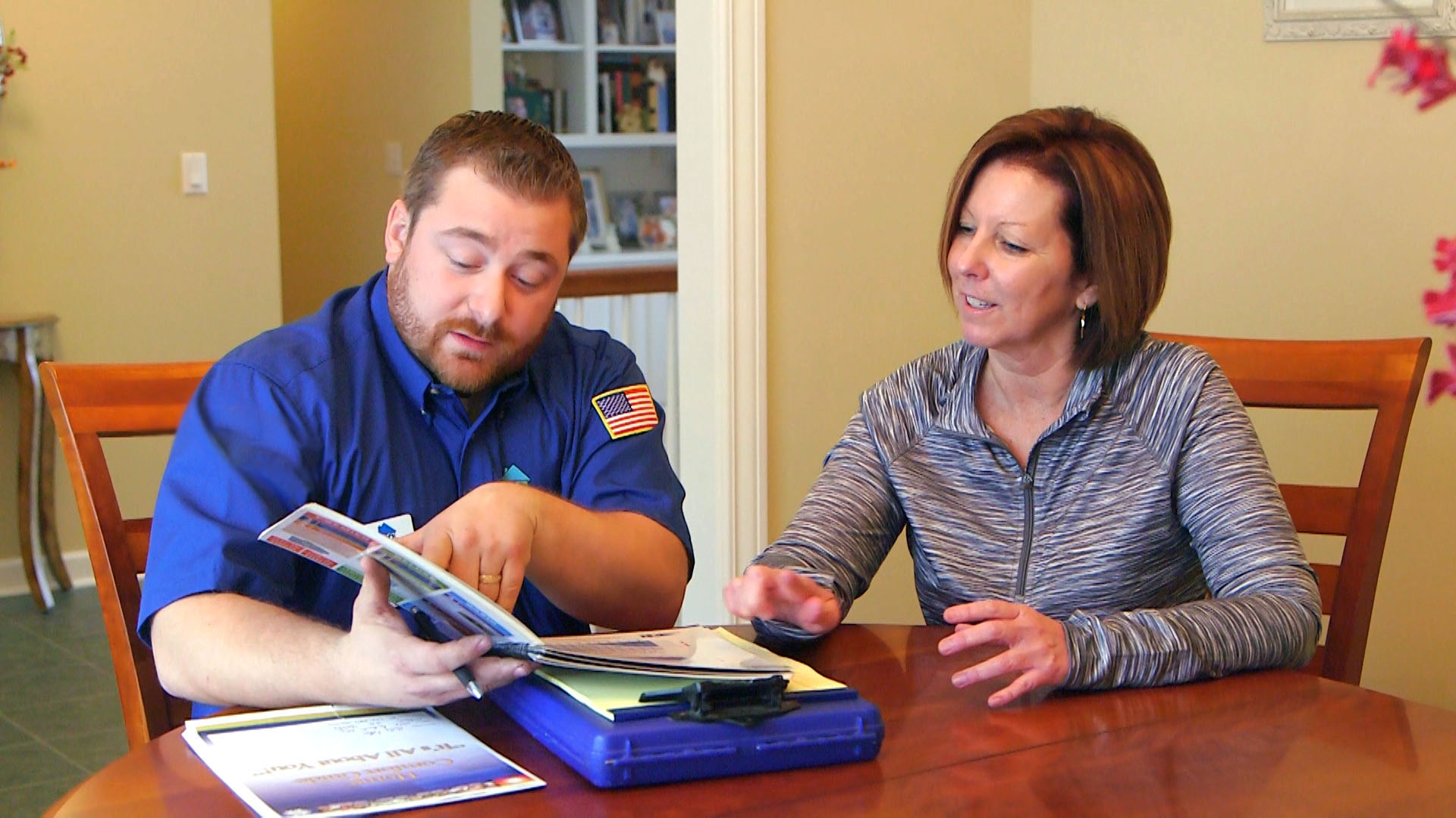 A heating contractor talking to a client